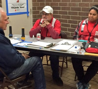 George Stanley Checks in with Red Cross Volunteers at the Branford Shelter